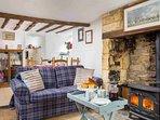 Open plan living room with log burner