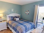The Blue Sails Bedroom has a comfy-cozy queen bed.  Decorated in coastal cottage style, you'll love sleeping here!