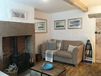 Lounge showing log burner - for this chilly evenings!