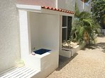 Outdoor shower and dive/snorkel gear rinse area.