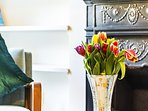 Original Edwardian fireplace, and flowers, what a delightful period feature.
