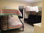 bunk room 2- 2 queen (or 1 futon), 2 twin, private bath