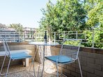 Interior opens to an undercover balcony with BBQ awash with sunlight