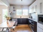 Sleek Caesar Stone kitchen w/stainless steel appliances