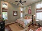 1st floor guest bedroom with a queen bed