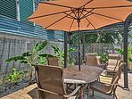 All that's missing from this furnished patio is a refreshing cocktail and you!