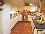 Prepare your favourite meal in the well equipped kitchen