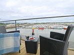 Relax on the balcony and enjoy fantastic views across Amble marina and beyond