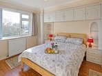 A bright ground floor king size bedroom