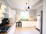 Open plan kitchen - linked with dining room & and separate utility room.