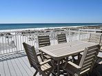 enjoy a fabulous view of the gulf from the large back deck with seating for everyone!