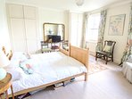 Spacious twin or double bedroom with TV & seating area.