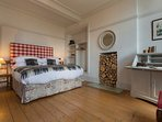 Large king-size bedroom with plenty of character