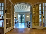 Grand French doors lead you into the lounge