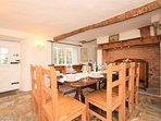 The dining area has a farmhouse vibe throughout