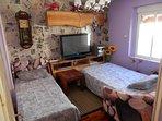 Salón con dos sofás-cama