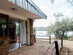 Waterfront guest bungalow with stone patio