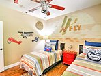 The boys will love sharing this aviation-themed room.