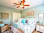 Beach-themed decor brightens each room.
