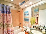 The tropical shower curtain will entice you to go to the beach!