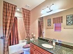 A fourth bathroom offers ample space for everyone to get ready.