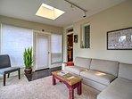Skylights and floor-to-ceiling windows let natural light illuminate the sunroom.
