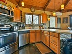 Stainless steel appliances complement the contemporary backsplash.