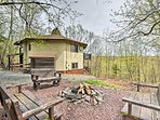 This home sleeps 12 and features a private outdoor fire pit.
