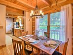 Admire wooded views while dining at the 4-person table.