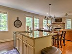 Granite counter tops embellish the kitchen and the center island.