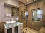 The en-suite master bathroom offers a walk in shower.