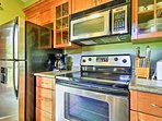 Stainless steel appliances and ample cookware elevate your cooking experience.