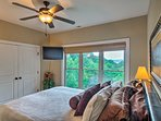 Enjoy the view from the bed while you watch the flat-screen TV.