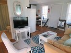 Enjoy your favorite show on the flat screen TV - Open view to kitchen and bath- - 46 Little Beach Road Chatham Cape Cod...