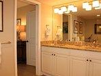 Master bathroom with wide double sink granite top vanity. New brushed nickle faucets, towel bars & rings.