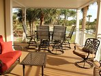 2903 patio with bar height dining table set (swivel stools) for six and separate swivel seating for two.         One of...