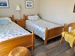 Guest bed has two twin beds with an attached full bathroom with tub/shower combination.