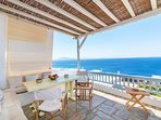 First floor balcony features a large table for breakfast,lunch or dinner with a view