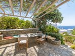 Garden stone table with sea view for big gatherings and tasteful dinners