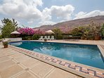 Outdoor Heated Pool with a Sit out area, a table Tennis Board and beautiful Flowers