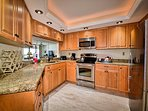 Generous kitchen space with granite counters.