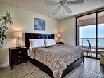 Master bedroom has balcony access and a view of the beach.