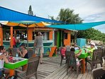 Relax at Santannas for lunch on their deck by the sea