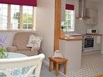 There are also two comfy chairs and a TV in the downstairs open-plan living area