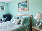 Beautiful soothing colors greet you in the spacious master bedroom.