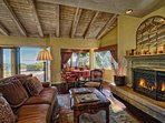 Cozy up with a book by the gas fireplace or enjoy breakfast in the family room nook with ocean and mountainside views