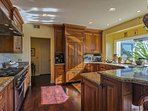 The kitchen is nicely outfitted with a Viking range, Sub-Zero refrigerator, Miele dishwasher, granite counters and a...