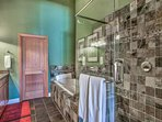 Guests in this room will enjoy the option of a walk-in shower or jetted tub.