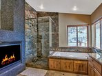 Yes, the fireplace extends to the master bathroom as well.