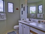 This bathroom has ample counterspace to get ready each morning!